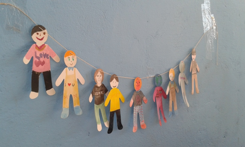 paper humans made by young residents in Oinofyta warehouse, refugee camp in Greece
